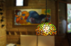 Lamp in rustic room Stock Photos