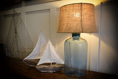 Lamp and sailboats Stock Photos