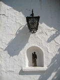 Lamp and Saint White Wall Royalty Free Stock Images