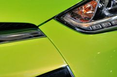 Lamp of sedan in green. Part of a sedan in green, with head lamp, which color and shape is beautiful, shown fantastic design and car manufacturing tecnology Stock Images