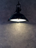 Lamp Shade from Modern Black Metal Lamp Hanging on Gray Wall Background with Copyspace to input Text used as Template Royalty Free Stock Photos