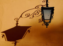 Lamp Shadow. Afternoon shadow from a street lamp in Dolores Hidlago, Guanajuato, Mexico Stock Photo
