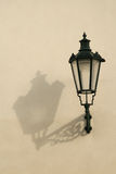 Lamp and shadow. Gas lamp on paited wall Stock Image