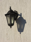 Lamp with shadow on the wall. Street lamp with shadow on the wall Royalty Free Stock Images