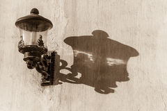 Lamp shadow on wall Royalty Free Stock Photo