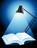 Lamp_shining_on_the_book Fotografía de archivo libre de regalías