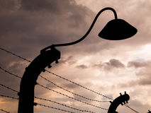 Lamp silhouette in concentration camp Stock Photos