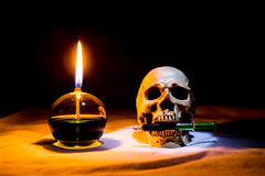 Lamp and skull with syring. In the dark night, Still life style Royalty Free Stock Photo
