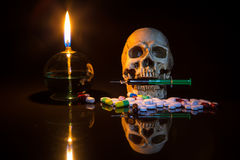Lamp and skull with syring. In the dark night, Still life style Royalty Free Stock Images