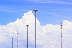 Lamp and sky. Lamppost group and blue sky background stock photography