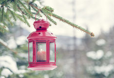 Lamp and snow in winter time. Lamp and snow and Christmas tree royalty free stock photo
