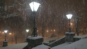 Lamp in the Snowstorm. At night