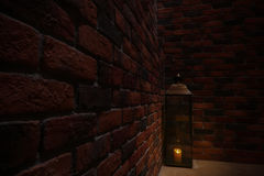 Lamp at the spot in the dark and the old brick wall Royalty Free Stock Images