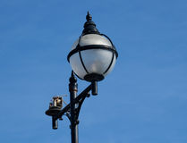 Lamp standard in street with broken fitting. Royalty Free Stock Images