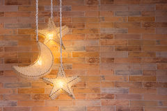 Lamp. Star and moon shape Lamp with brick wall stock photos