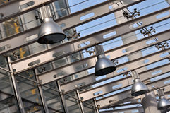 Lamp in steel structure construction. Lamp hanging on steel structure architecture by sequence, shown as repeat composition and shape, or industrial concept in Stock Image