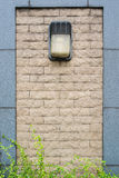 Lamp on the stone wall Royalty Free Stock Photo