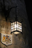 Lamp on the stone wall Stock Images