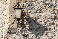 Lamp on a Stone Wall Trencin Slovakia Royalty Free Stock Photos