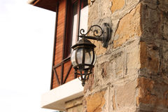 Lamp. Street carved lantern on the facade of a brick house Stock Photo