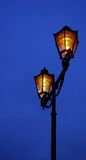 A lamp. A street historic lamp shining at night Stock Images
