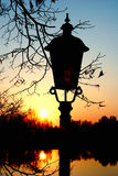 Lamp in sunrise. Lamp on the lake side Stock Photo