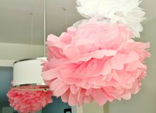 Lamp surrounded by pompoms Stock Image