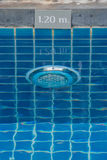 Lamp in swimming pool with warning sign showing the depth of the swimming pool. Royalty Free Stock Photography