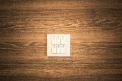 Lamp switching on  wood walls. Lamp switching on the wood walls Royalty Free Stock Photos