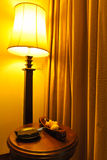 Lamp and table in a hotel Royalty Free Stock Photography