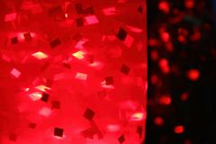 Lamp on the table with red glitter. The lamp on the table with red sparkles glows at night Stock Photos