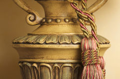Lamp on Table with Tassel. Lamp on Table with Ornate Hanging Tassel Royalty Free Stock Images