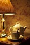 Lamp and tea service Stock Photos