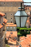 Lamp and terracotta roofs Stock Image