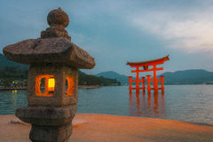 Lamp and torii in Miyajima island, Japan Royalty Free Stock Photography