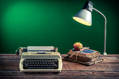 Lamp and typewriter in the classroom Stock Image