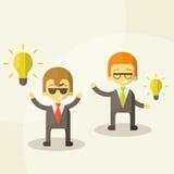 Lamp van ideeconcept, zakenmanpartners Stock Afbeeldingen