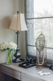 Lamp with vase of plant on dressing table Royalty Free Stock Photo