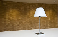 Lamp & wall. Lamp in front of a wooden wall Stock Image