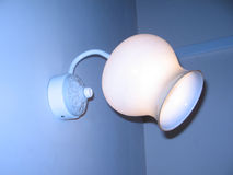 Lamp on a wall. Dark, electrical, electricity, electronics, fear, flash, illumination, Lamp, light, photon, ray, room, wall Stock Photography