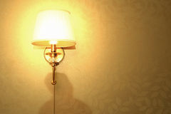 Lamp on the wall, bright light Stock Images