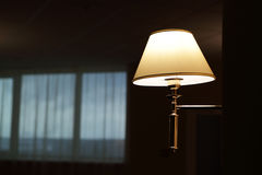 Lamp on wall in hallway at night Stock Image