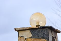 Lamp on the wall of the house fence.  Stock Photo