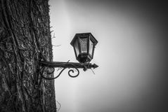 A lamp on a wall. A lantern on an old wall Stock Image