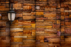The lamp on the wall made of stone blocks. Royalty Free Stock Image
