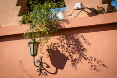 Lamp on the wall in the Marrakech Medina Stock Photography