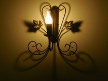Lamp. The lamp on the wall. night light, shadow, romance, comfort, design, home lighting Royalty Free Stock Photo