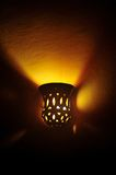 Lamp on a wall shining Stock Image