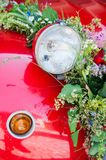 Lamp of a wedding car. Lamp of a red wedding car with flower bouquet Stock Images