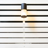 Lamp on white lath wall Stock Photos